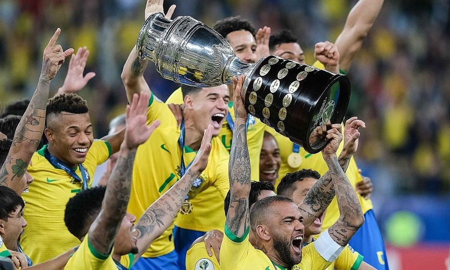 Brazil captain and Golden Ball winner Dani Alves hoisting the Copa America trophy after the hosts defeated Peru 3-1 in the final at the Maracana on Sunday. It was the Selecao's ninth triumph in the continental competition. Gabriel Jesus taking out hi