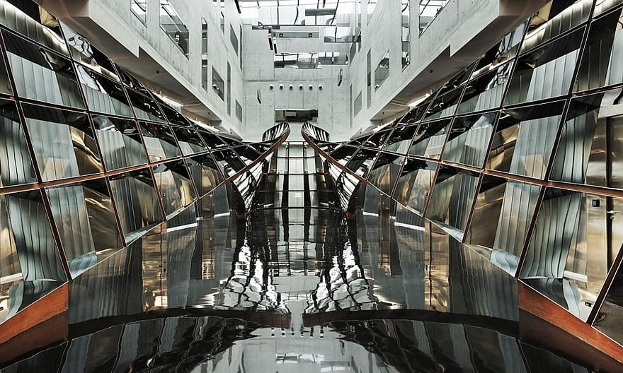 Le Freeport's atrium (left) is dominated by a 38m-long sculpture of polished steel by Israeli artist Ron Arad called the Cage Without Borders. Opened in 2010 at a cost of about $100 million, the vault sits on a large tract of government land with dir