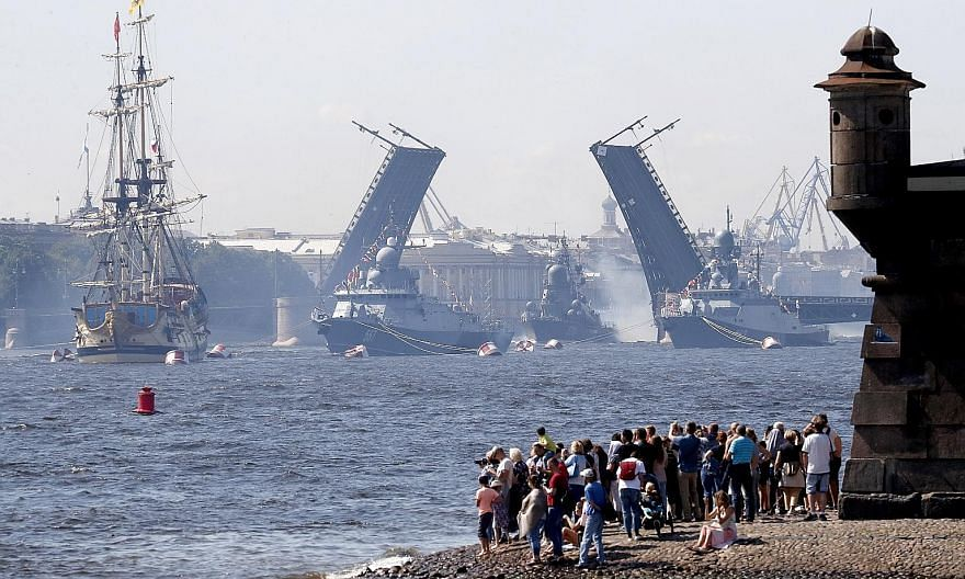 The Russian Navy's small missile corvettes (from far right) Serpukhov, Passat and Mytishchi as well as sailboat Poltava taking part in a rehearsal for Russia's Navy Day parade in St Petersburg yesterday. Navy Day is celebrated on the last Sunday of J