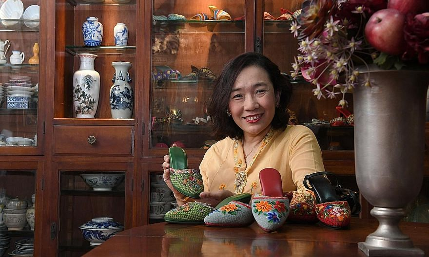 Ms Angeline Kong with her great-grand-aunt's green kasut manek (Peranakan beaded shoes) and two newer pairs that she made herself. ST PHOTO: DESMOND FOO