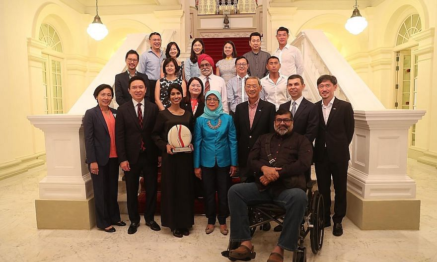 President Halimah Yacob at the awards ceremony for the Singaporean of the Year 2018 earlier this year. Front row, from left: UBS head of Asean equities Yeoh Choo Guan; UBS Asia-Pacific president Edmund Koh; Singaporean of the Year 2018 winner Siti No