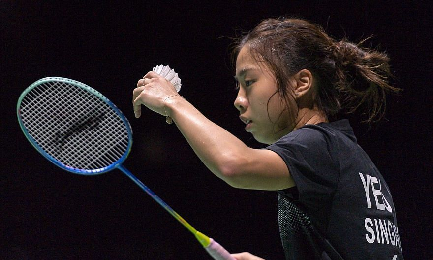 Left: Singapore's Yeo Jia Min on her way to beating world No. 1 Akane Yamaguchi last night. She attributed her success to her ability to stay focused. Below: Loh Kean Yew celebrating a point against Sameer Verma at the World Championships in Basel. T
