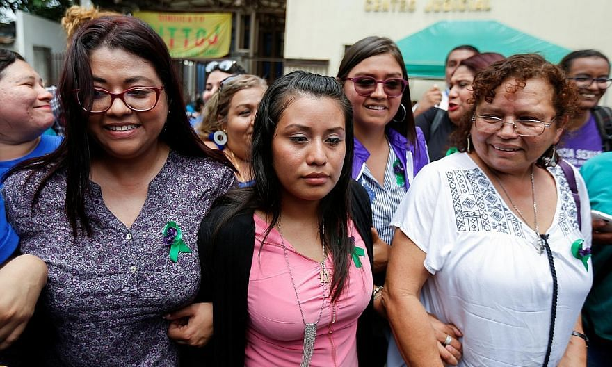 Ms Evelyn Hernandez (in pink), who has already served three years of a 30-year sentence for intentionally inducing an abortion, was freed on Monday by a court in El Salvador.