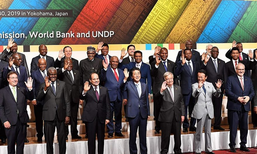 "Japan's Prime Minister Shinzo Abe (centre), flanked by African Union chairman and Egyptian President Abdel Fattah al-Sisi and UN chief Antonio Guterres in a ""family photo"" with other participants at the Tokyo International Conference on African Devel"