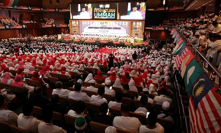 Umno and PAS members at the Himpunan Penyatuan Ummah, or Unity Gathering of the Muslim Faithful, in Kuala Lumpur on Sept 14. Leaders of the two parties signed a cooperation pact, which has a focus on Malay and Muslim issues. PHOTO: REUTERS