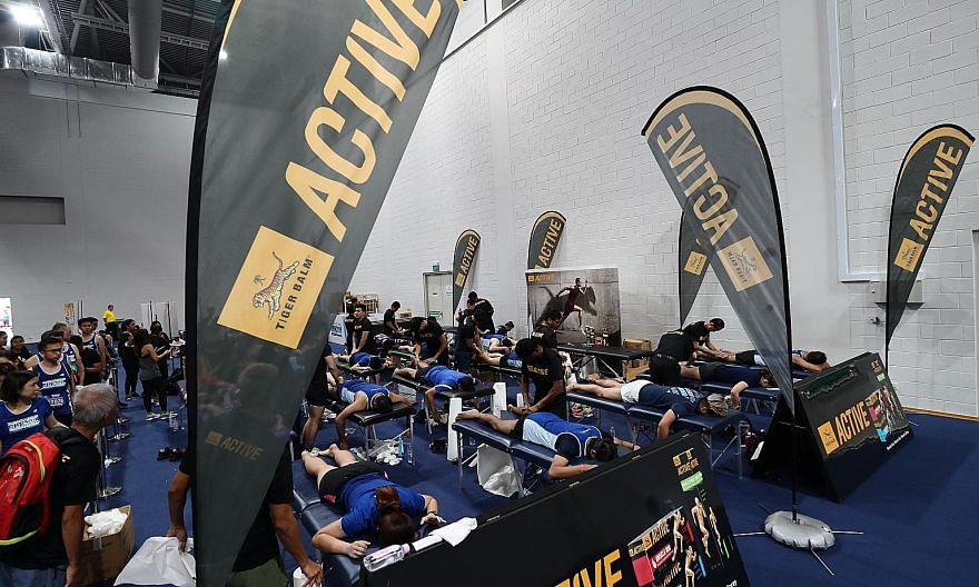 Runners getting some muscle relief at the Tiger Balm Recovery Zone at the OCBC Arena after yesterday's ST Run.