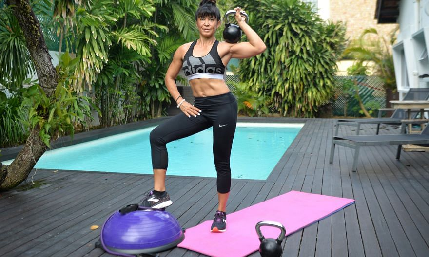 Mrs Sharona Hurmuses, a personal trainer and a mother of three, exercises regularly at home by her pool.