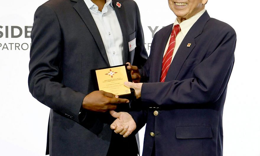 Mr Muhammad Ashik Mohamed Daud (above) was given a Commendation Award, while Mr B. Senraya Perumal (right) received the High Commendation Award from Singapore Red Cross chairman Tee Tua Ba.