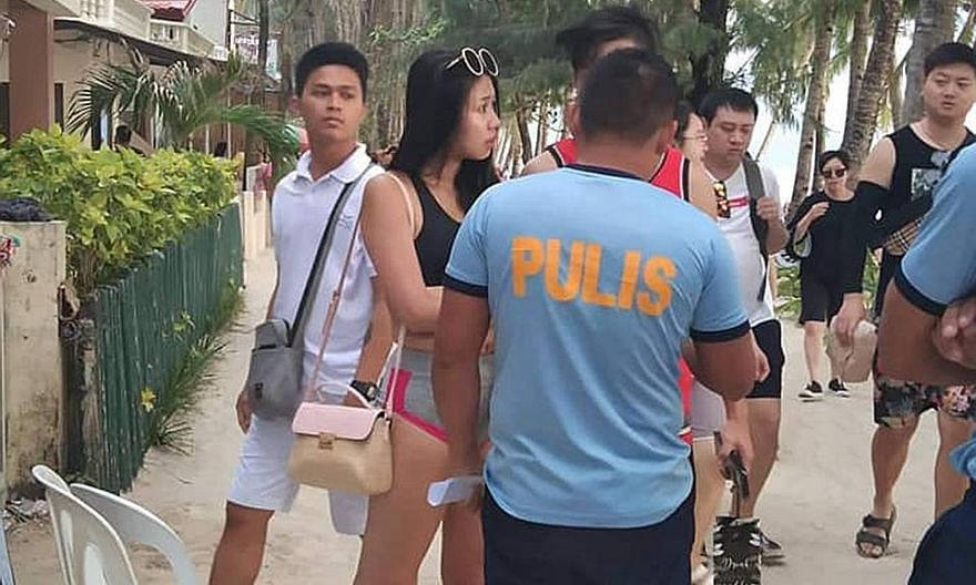 A Taiwanese woman was summoned to the Boracay police station after photos of her wearing a two-piece string bikini along the famous white beach of the island circulated on social media. She was fined 2,500 pesos (S$67). PHOTO: COURTESY OF TRISTAN GEL
