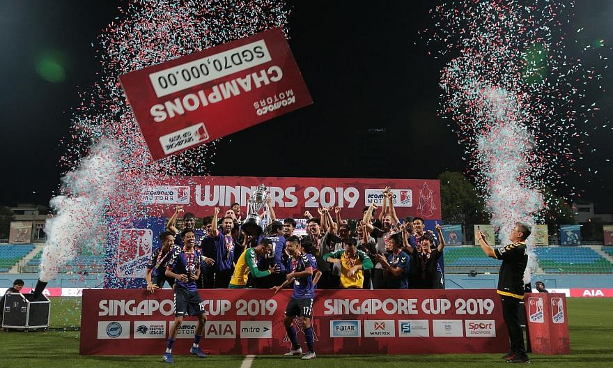 The victorious Tampines Rovers team celebrating their Singapore Cup win as the winners' cheque is airborne at the Jalan Besar Stadium. The Stags edged Warriors FC 4-3 in yesterday's final.
