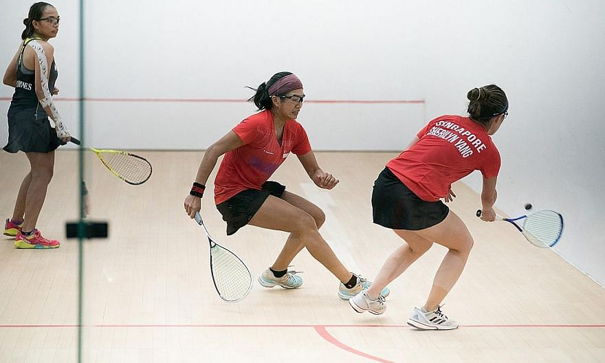 Singapore's Mao Shi Hui (centre) and Sherilyn Yang winning the jumbo doubles title at the Kuala Lumpur SEA Games in 2017. It was one of three gold medals won by the Singapore squash team. PHOTO: SPORT SINGAPORE