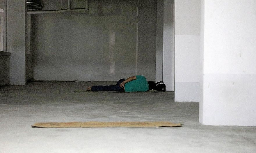 Half of the homeless had been toughing it out on the streets for between one and five years, and nearly one-third did so for six years or longer. They slept in places like void decks, commercial buildings and playgrounds. ST PHOTO: WANG HUI FEN