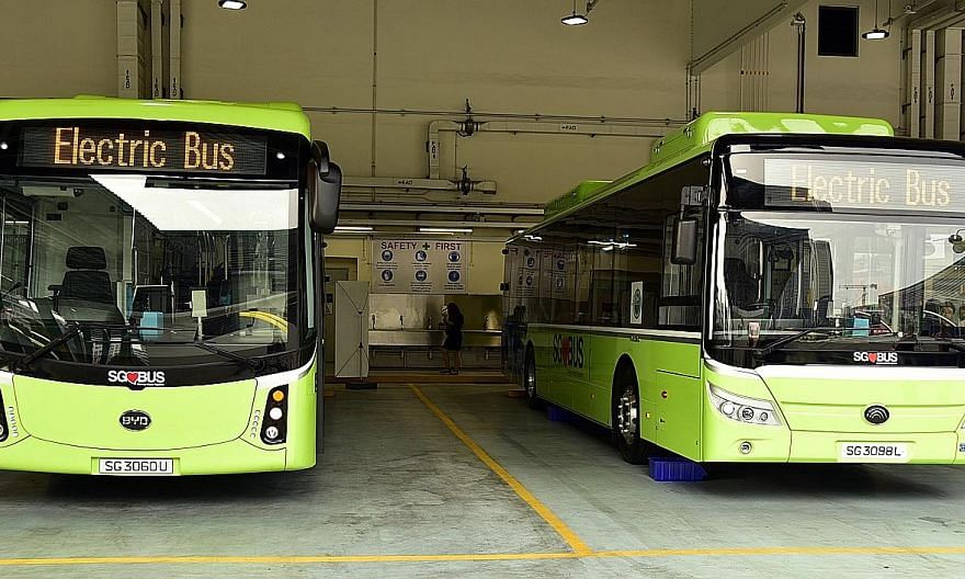 Above: Electric buses from Chinese firms BYD (left) and Yutong. Right: A diesel bus retrofitted with an electric power train, in an experiment by LTA as part of a proof-of-concept trial to determine the feasibility of converting existing diesel buses