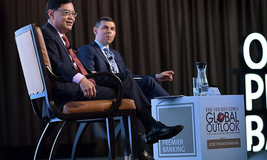 ST PHOTO: NG SOR LUAN Deputy Prime Minister Heng Swee Keat with Mr Warren Fernandez, editor-in-chief of Singapore Press Holdings' English/Malay/Tamil Media Group and editor of The Straits Times, at The Straits Times Global Outlook Forum yesterday. ST