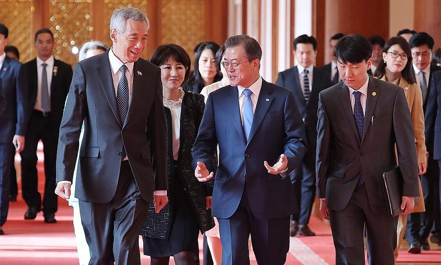 Prime Minister Lee Hsien Loong with South Korean President Moon Jae-in at Seoul's presidential Blue House yesterday, where the two leaders witnessed the signing and exchange of cooperation pacts in standards and conformance, manufacturing of pharmace