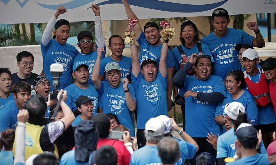"Mr Benson Loo (holding up medals), 39, cheering on the podium with his teammates from Team DragonSail GoGoGo after winning the ""DB22 Adaptive Open"" race with a timing of 57.26sec during the DB Hearts Challenge 2019 dragon boat event, held at PAssion WaVe"
