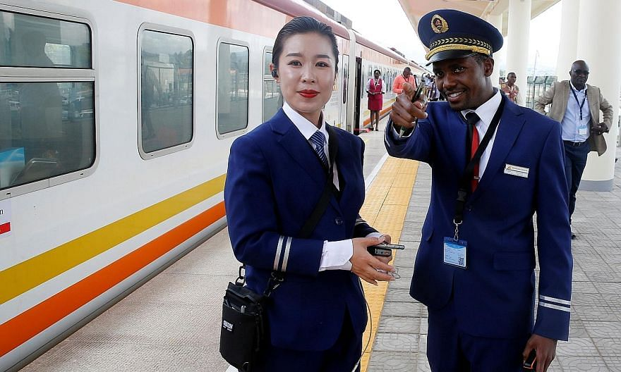 Kenya Railways attendants at a station - on a line built by the China Road and Bridge Corporation and financed by the Chinese government - in Ongata Rongai town in Kenya. Surveys of employment on Chinese projects in Africa have found that three-quart