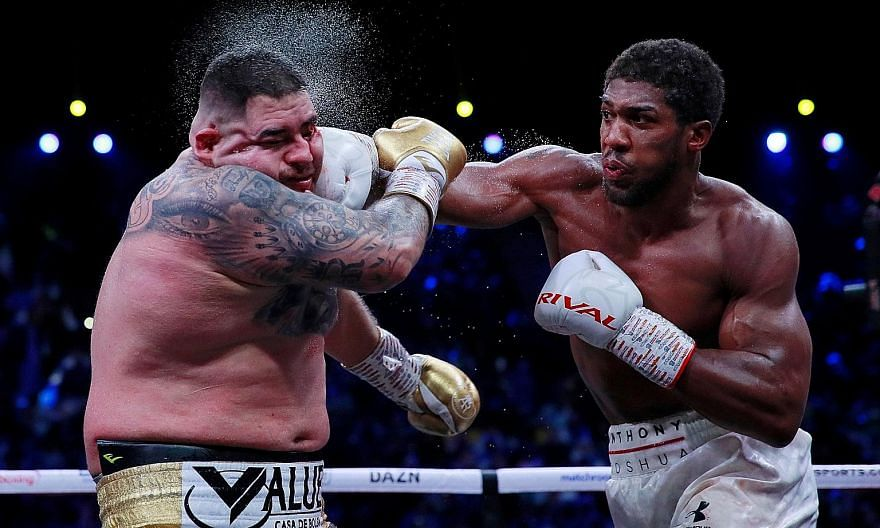 Anthony Joshua landing a punch on a clearly overweight Andy Ruiz Jr at the Diriyah Arena in Saudi Arabia on Saturday. The Briton gained revenge over the Mexican-American to win the WBA, WBO and IBF heavyweight titles.