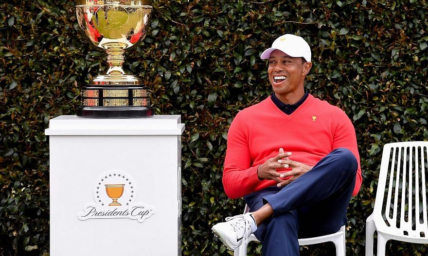 Tiger Woods, the United States' playing captain, is in good spirits while waiting for teammates during a photo session at the Presidents Cup at Royal Melbourne in Australia. The Americans are defending their title in the biennial matchplay event agai