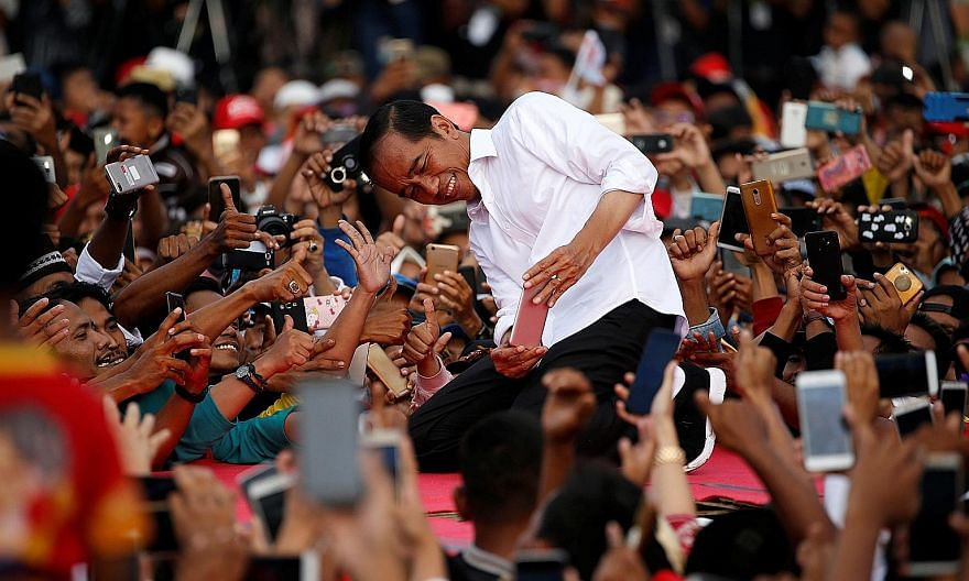 Indonesia's President Joko Widodo (left) and Thailand's Prime Minister Prayut Chan-o-cha on the campaign trail earlier this year. Both were returned to office. Mr Joko will now have to face the challenge of balancing economic growth with socio-cultur
