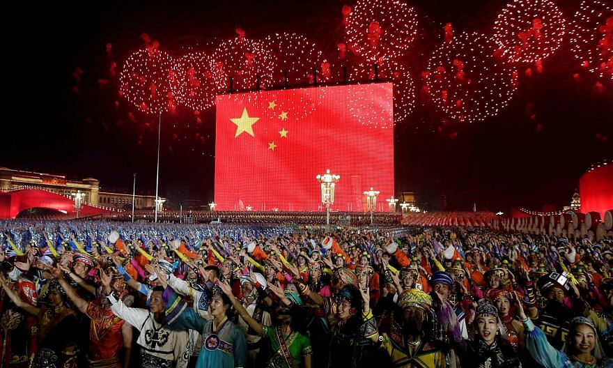 Performers at an evening gala in Beijing's Tiananmen Square to mark the 70th founding anniversary of the People's Republic of China on Oct 1.