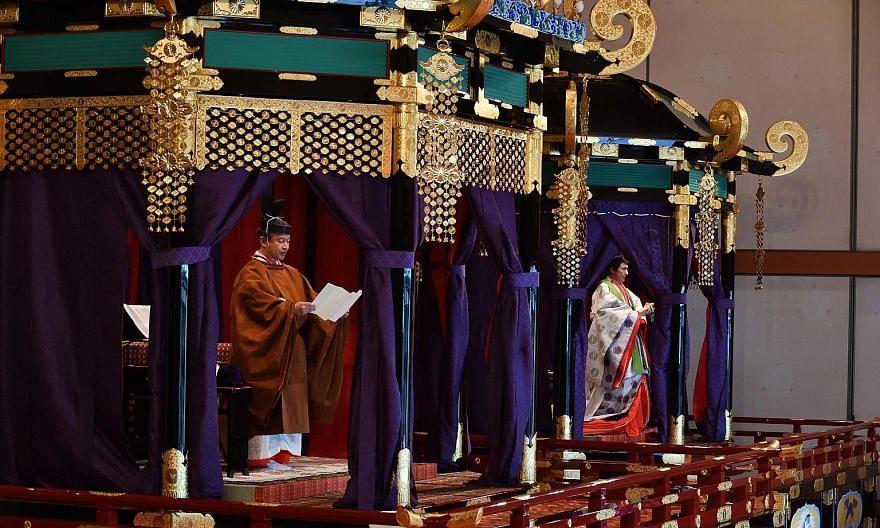 Emperor Naruhito delivering a speech at his enthronement ceremony with Empress Masako at the Imperial Palace in Tokyo on Oct 22. PHOTO: AGENCE FRANCE-PRESSE