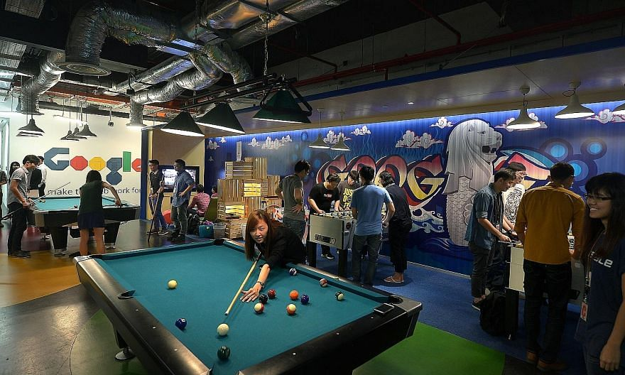 Google employees chilling out at one of the many recreational spaces at its Singapore office. Other perks include free meals and napping pods.
