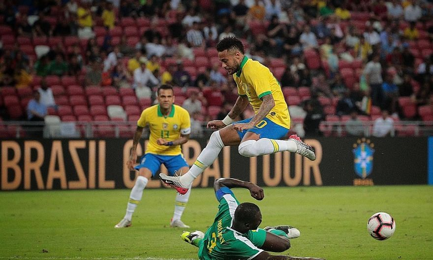 Brazil's Neymar riding a challenge from Senegal skipper Kalidou Koulibaly. The teams played out a 1-1 draw to a half-filled National Stadium.