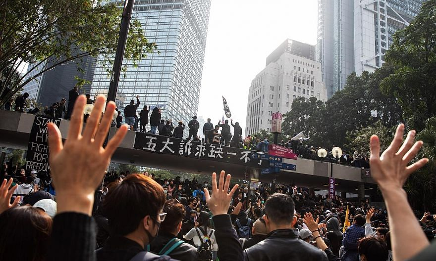 What characterises the protest movement in Hong Kong is its fluid, leaderless, organic character, with social media reinforcing beliefs and biases. The writer says there are larger, deeper forces at work in the city. PHOTO: BLOOMBERG