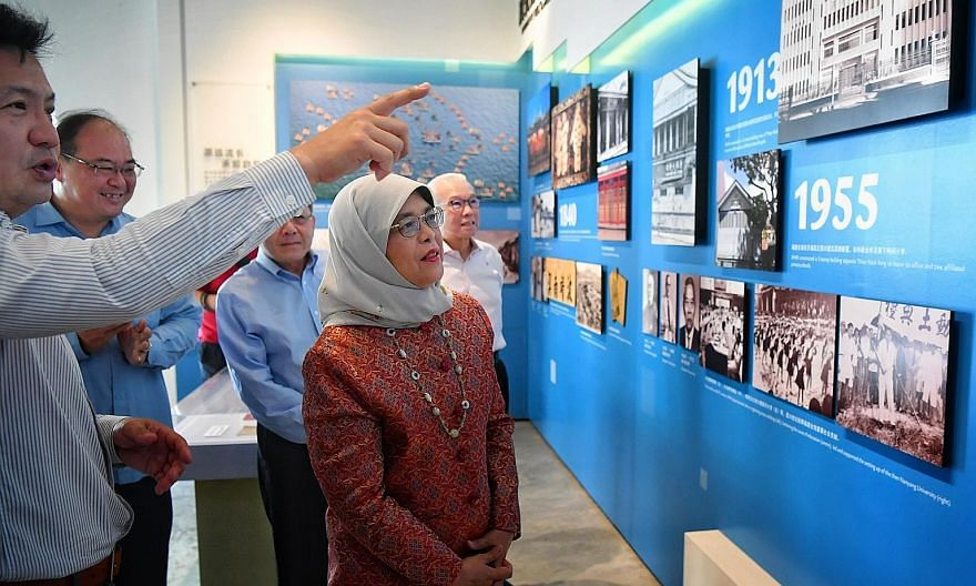 Singapore Hokkien Huay Kuan (SHHK) vice-president Chan Hock Keng giving President Halimah Yacob a tour of the clan association's gallery yesterday. Madam Halimah spoke to about 50 attendees at the SHHK Cultural Academy in Sennett Road as part of her