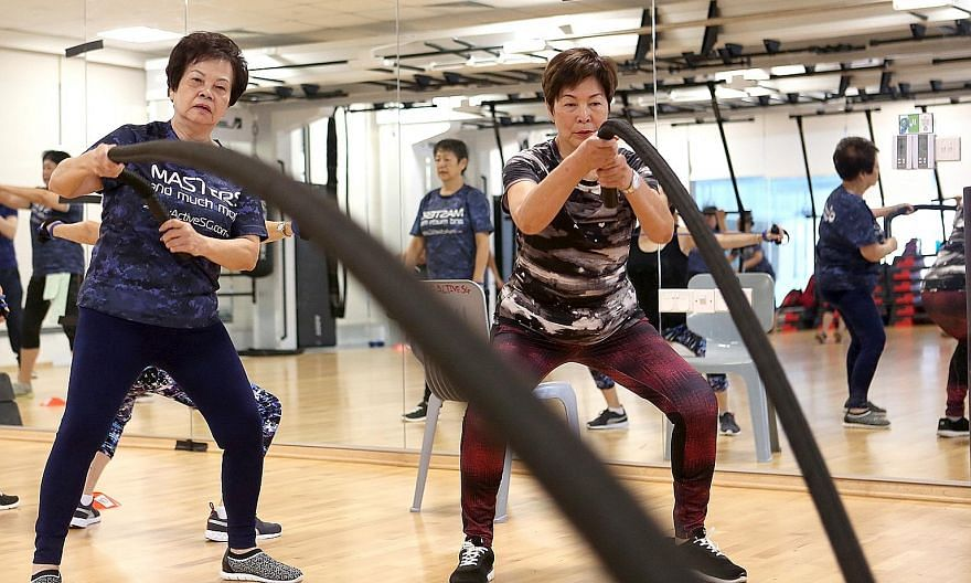 Madam Doris Mok (left), 70, and Ms Alice Tan, 72, taking part in a class at Heartbeat@Bedok ActiveSG Gym yesterday. They are among senior citizens who will benefit from the free access to ActiveSG's 26 pools and 24 gyms.