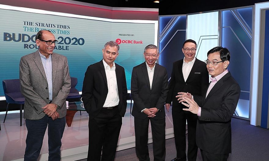 Deputy Prime Minister Heng Swee Keat with (from left) Straits Times associate editor Vikram Khanna, Institute of Policy Studies senior research fellow Faizal Yahya, OCBC Bank head of global commercial banking Linus Goh and Ademco Security Group manag