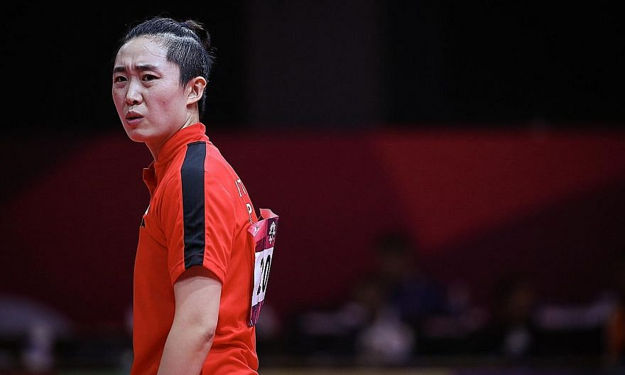 An upset Feng Tianwei during her last-16 singles loss at the 2018 Asian Games in Indonesia. She is bidding to become the oldest female table tennis Olympic medallist. ST FILE PHOTO