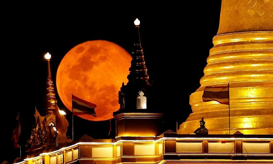 The pink supermoon rising over Wat Saket, also known as the Temple of the Golden Mount, in Bangkok on Wednesday. Seen over Tuesday and Wednesday in various regions of the globe, it was the largest and brightest of the full moons that the world will s