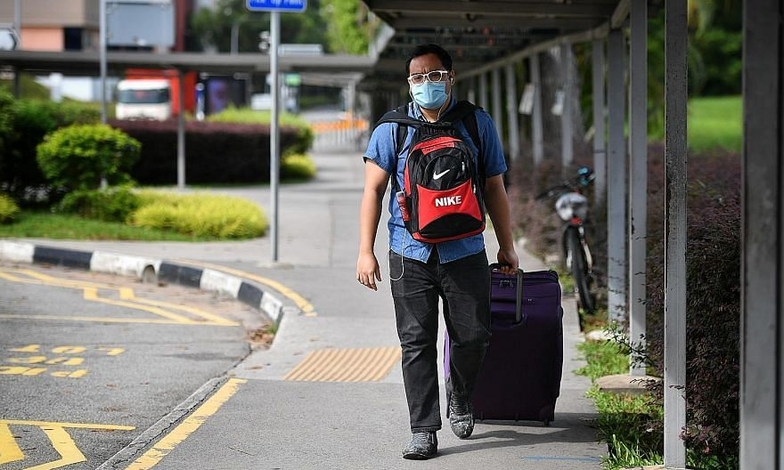 Malaysian Muhammad Bari Arshad, 28, a management trainee, leaving Singapore yesterday morning to return to Malaysia, as new rules for returning Malaysians kicked in.