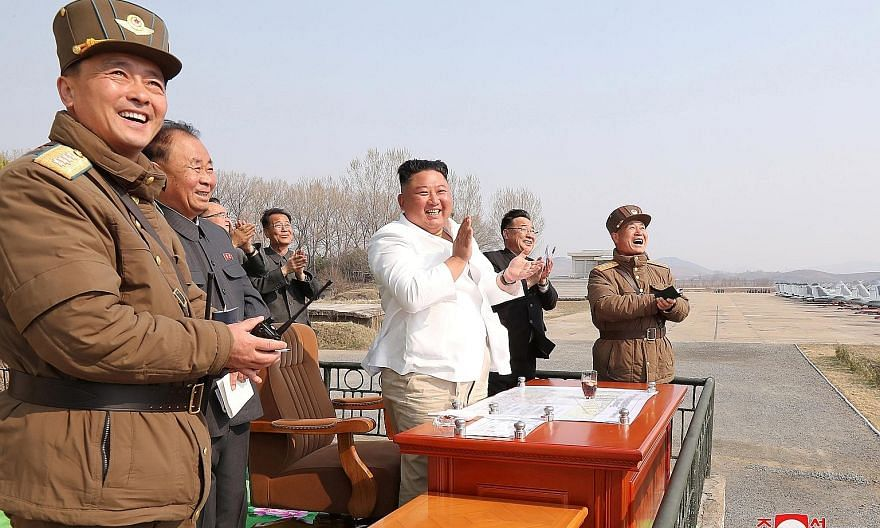 An April 12 photo showing North Korean leader Kim Jong Un applauding during a visit to a pursuit assault plane group in Pyongyang.