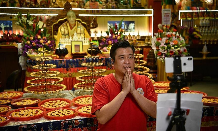 Mr Bryan Long, manager of Thekchen Choling temple near Lavender Street, preparing for a livestream of a ceremony on the eve of Vesak Day. Buddhists in Singapore yesterday geared up for a Vesak Day taking place today amid tight safe distancing measure