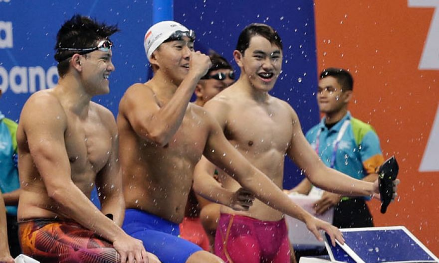From left: Singapore swimmers Joseph Schooling, Quah Zheng Wen and Darren Lim celebrating after clinching the 4x100m freestyle gold medal at the 2018 Asian Games in Jakarta.