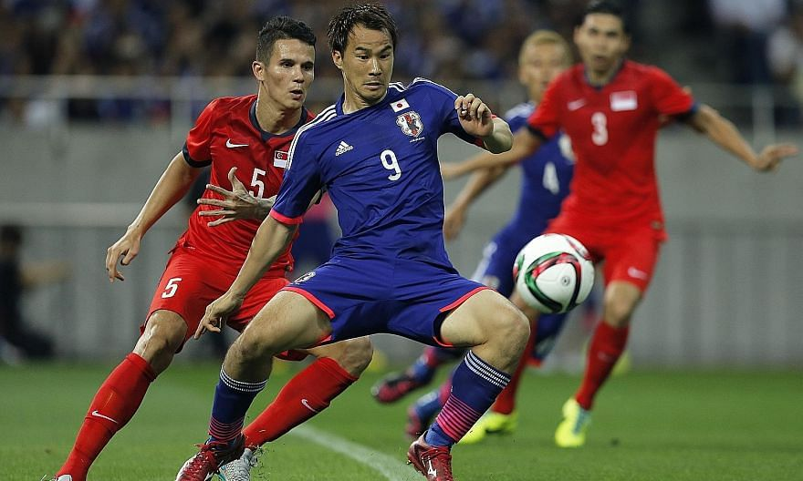 Japan's Shinji Okazaki on the ball as Singapore's Baihakki Khaizan marks him during the 2018 World Cup Asian qualifiers second-round match at the Saitama Stadium in June 2015. The game ended 0-0 as the Lions pulled off a stunner. PHOTO: EPA-EFE