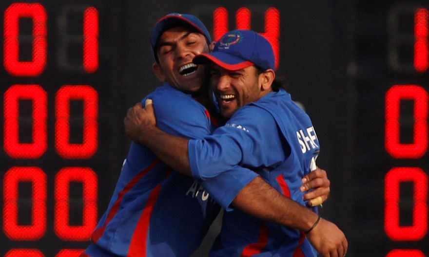 Shafiqullah Shafaq (far right) and Samiullah Shinwari celebrating a Bangladesh wicket in the 2010 Asian Games final, as Afghanistan took the silver after losing by five wickets. PHOTO: REUTERS