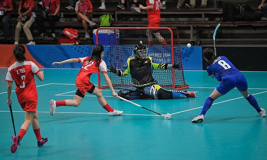 Singapore's women's floorball and netball teams competing at last year's SEA Games and the Asian Championship in 2018 respectively. Both sports will be included at next year's Asian Indoor and Martial Arts Games.