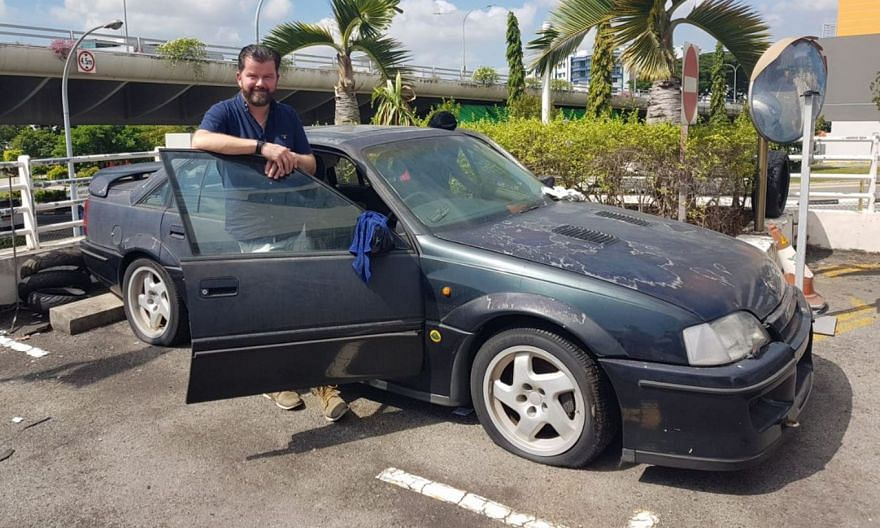 London-based Paul Mitchell came to Singapore to acquire the Lotus Carlton (above) in February last year. He converted his garage at home into a workshop, so that he could work on restoring the car.