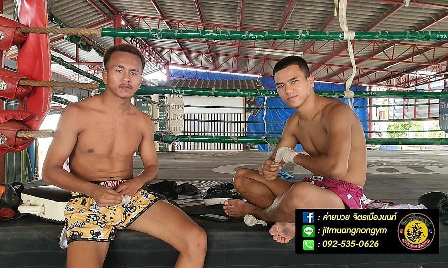 """Mr Sunthorn """"Payak"""" Saengngeon (left) and his brother Tewan """"Panpayak"""" Saengngeon are among the kickboxers in Thailand who have not been able to practise, much less fight bouts, as the country locked down to battle the coronavirus."""