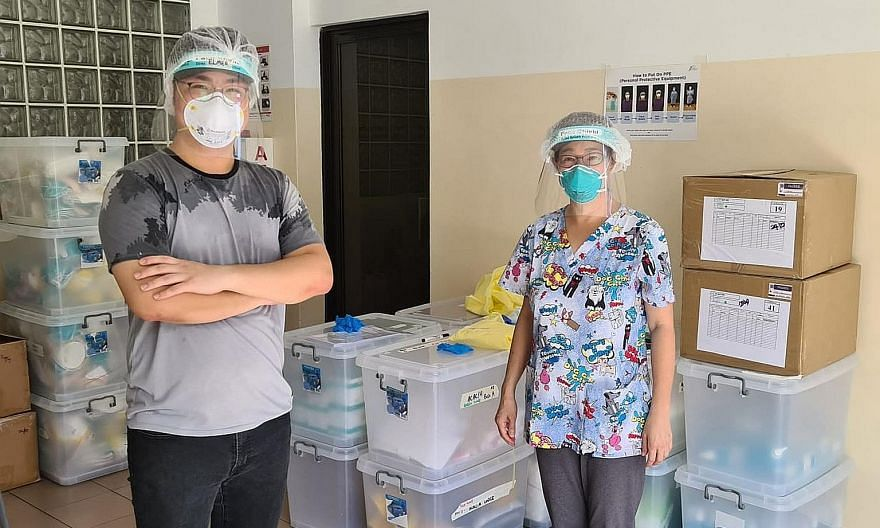 "Volunteer ""swabber"" Elmer Chan (left), who graduated last month with a diploma in aviation management and services, with Dr Lim Lii, who carries out swab tests and trains would-be ""swabbers""."