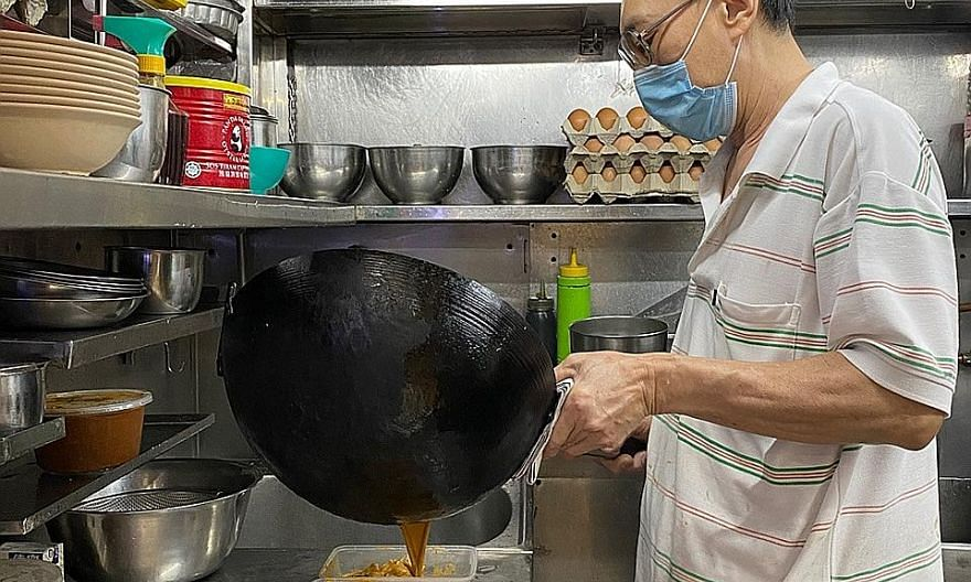 Mr Yeo See Hock, who runs Meng Kee Seafood stall at Pasir Panjang Food Centre, ladling out dishes for delivery orders. Mr Yeo said that because he has to keep prices low, the profit margins are also low. He could not afford the 30 per cent commission