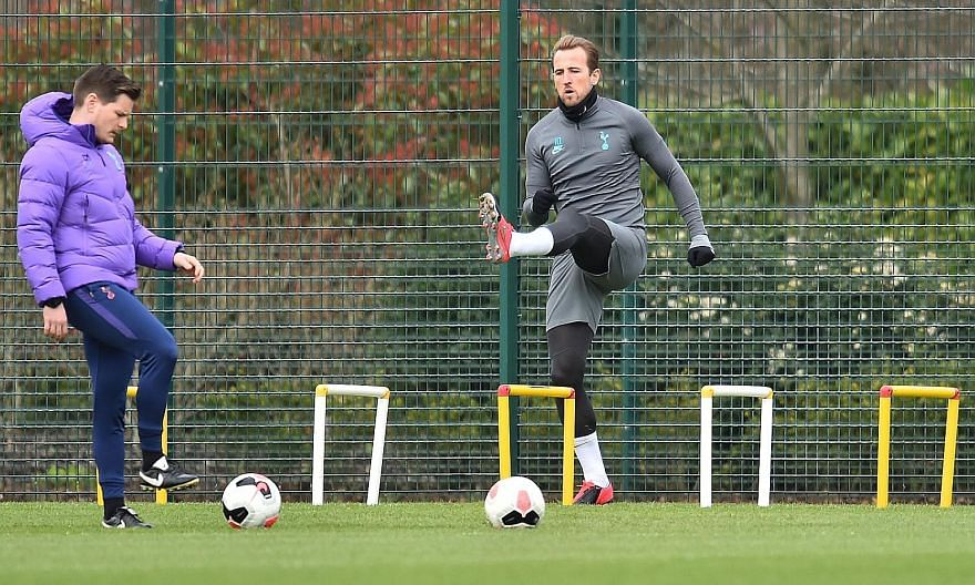 Harry Kane warming up during a Tottenham training session before the Premier League was suspended in March. The three-month hiatus has allowed the striker to recover from an operation on his hamstring and he is set to feature when action resumes this