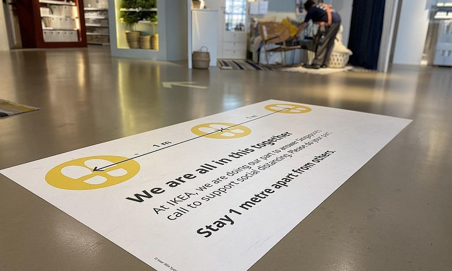 A sign at Ikea Tampines on maintaining safe distancing. Apart from safety precautions, Ikea stores will have shorter opening hours.