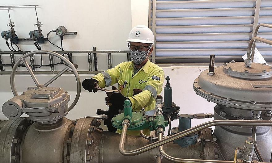A member of the SP Group gas operations team at an offtake station conducting checks on the gas regulators. The utilities firm is adjusting the gas pressures within the transmission and distribution network for residential and industrial customers as Sing