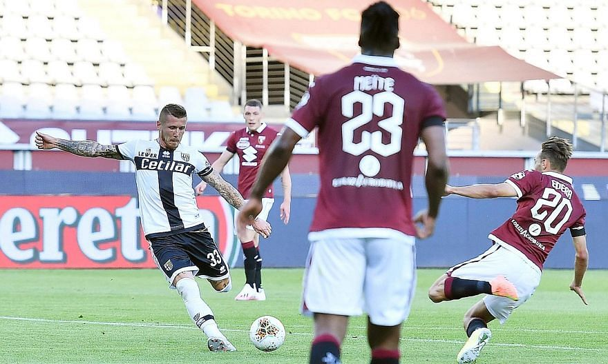 Parma's Juraj Kucka scoring the goal that earned his side a 1-1 draw against Torino in the Serie A on Saturday. The match in Turin was the first in the Italian top flight in 103 days. In the later game, 10-man Verona held on to beat Cagliari 2-1. Both fix