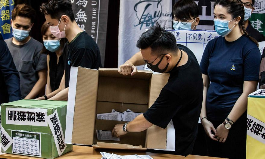 A volunteer emptying a ballot box in Hong Kong last Saturday, following a vote organised by a selection of pro-democracy unions to ask members if they would participate in a citywide strike and if they supported China's plans to impose a new national